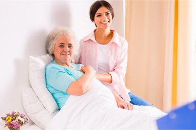 patient and a woman smiling