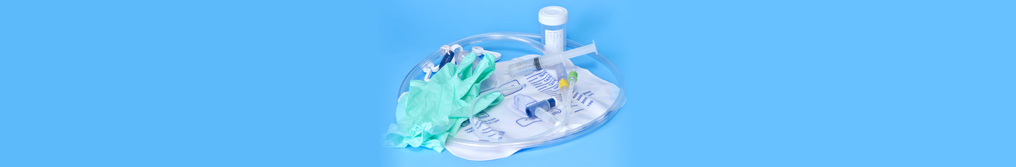foley catheter and drainage bag with sterile gloves and specimen container